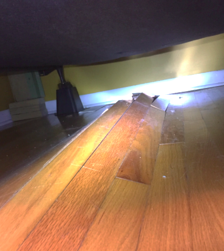 Buckled hardwood floors caused by uncontrolled humidity in the crawlspace.
