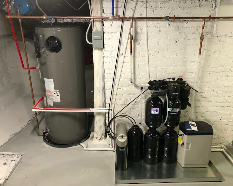 Heat pump water heater connected to a whole-home water purifier